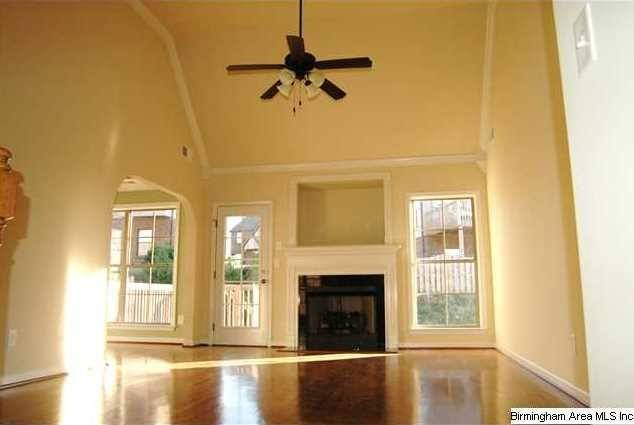 Great Room Has Gleaming Hardwoods High Vaulted Ceiling