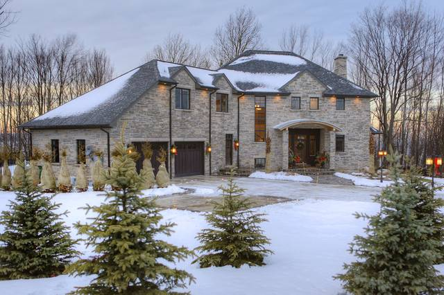 Limestone Home Winter Traditional Exterior