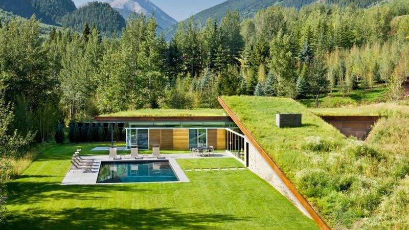 Modern House Roof Integrated Into Mountains