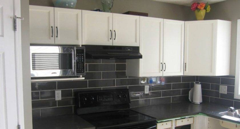 White Shaped Cabinetry Granite Countertop Grey