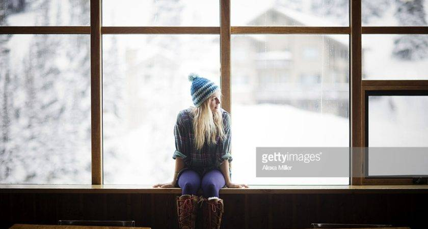 Young Woman Sitting Window Getty